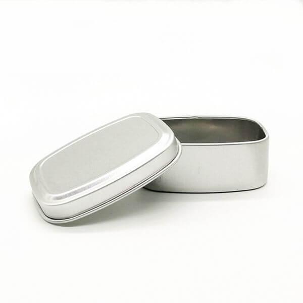 small rectangular slipcover tin