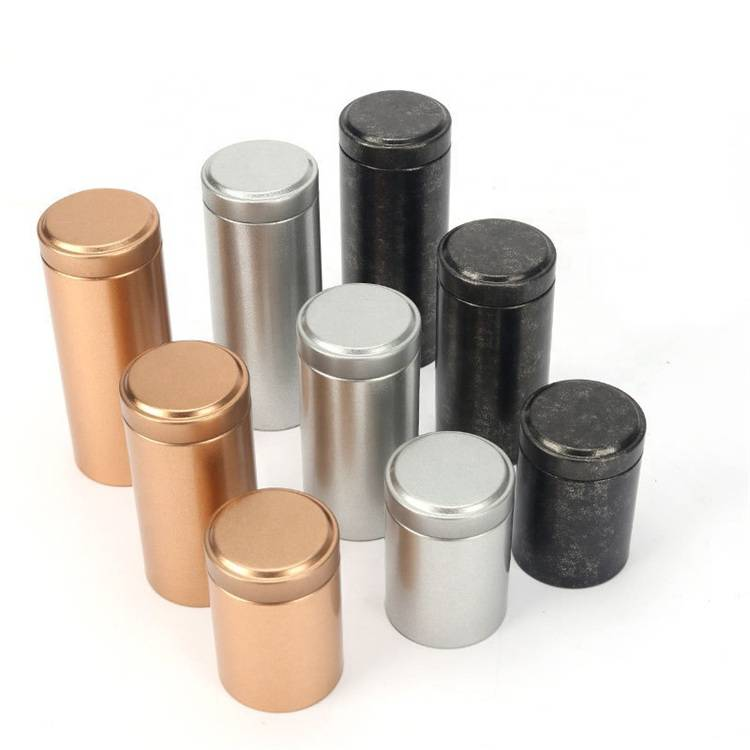 small round tea tins